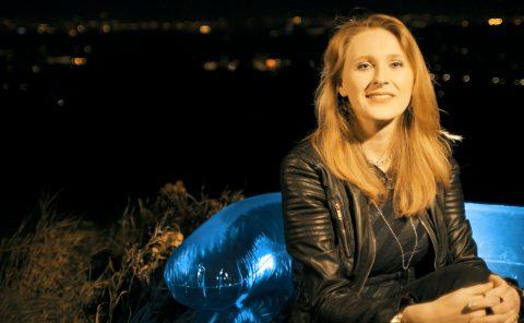 Cara Cole on a blue sofa